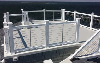 white rooftop deck by ocean