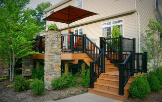 wood deck with black metal railings